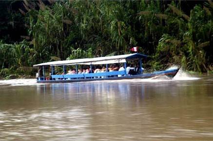 A motorized canoe will take you to and from the Posada Amazonas