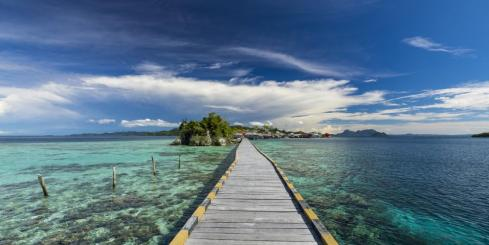 Walk out over the crystal clear waters of Indonesia