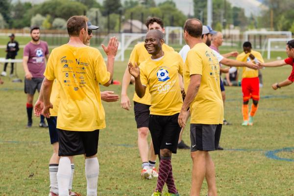 Soccer tournament participants congratulate each other on a good game