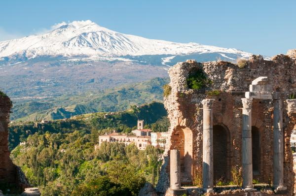 Explore ruins in Taormina within view of volcanic Mount Etna