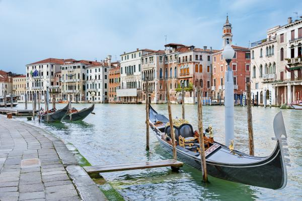 Take a classic gondola ride through Venice's canals