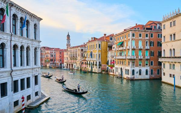 Enjoy a gondola ride through beautiful Venice