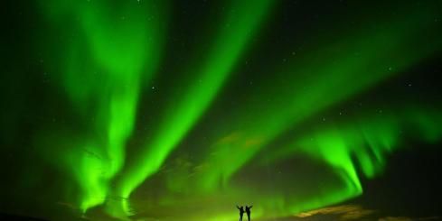 The Northern Lights dance across the sky