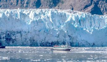 A small ship gets close to the glacier for a better look