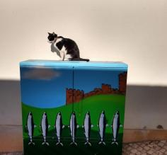 Cat and Sardines in Silves, Portugal