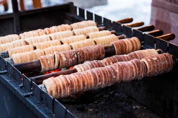 Taste the delightful street treats of Prague, such as trdelnik, or chimney cakes
