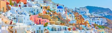 Wander through the maze of colorful buildings on Santorini