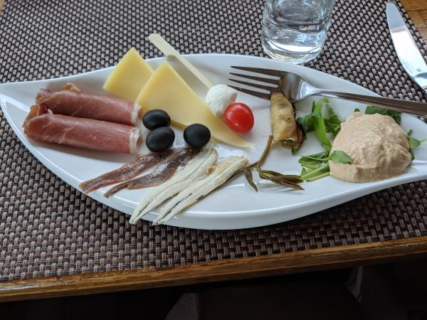 Typical Croatian foods, prosciutto, olives, salted fish and cheeses