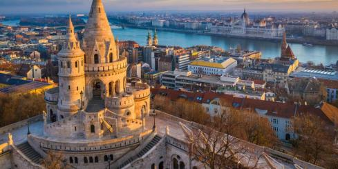 Golden sunset lights the famous Fisherman's Bastion in Budapest