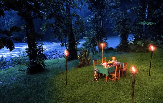 Dine by candlelight by the Pacuare River