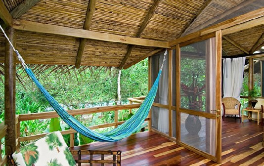Take a siesta in a comfortable hammock in your River View suite