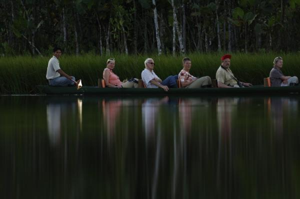 Explore the Amazon around Sacha Lodge in a traditional dug out canoe