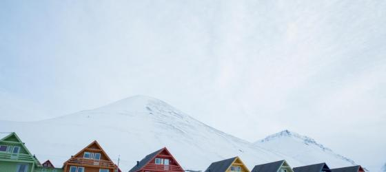 Admire the colorful houses of Longyearbyen