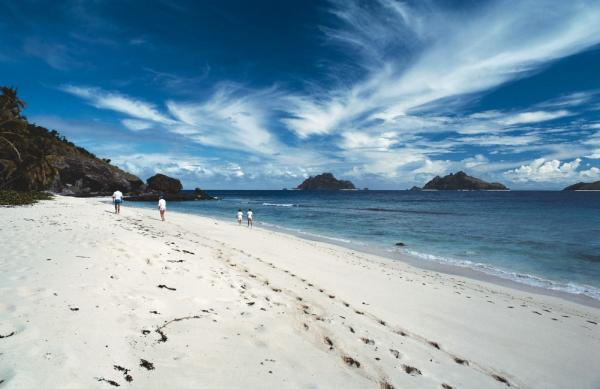 Stroll along perfect white sand beaches as you explore the islands of the South Pacific