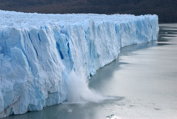 Piece of ice collapses as the glacier advances