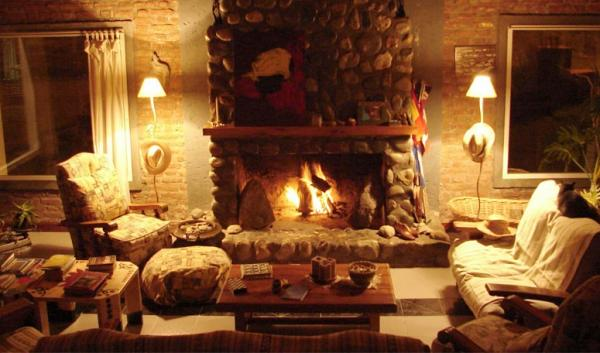 Relax by the fire at Hosteria Posada Lunajuim