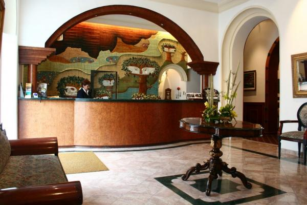 Experience a warm welcome at Hotel Crespo reception