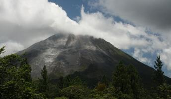 Huge rocks rolling down Arenal Volcano, view from AOL garden