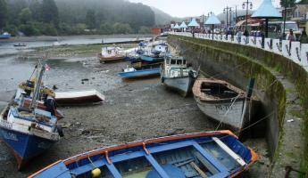 Fishing boats wait for the tide to rise