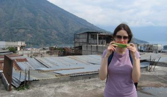 Eating watermelon on the roof of the Santiago market