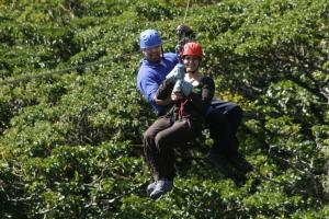 Tandem zip line through the Costa Rican rainforest canopy