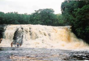 Enjoy the mist of a cascading waterfall in the Amazon