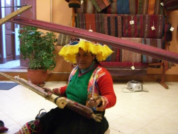 A weaver at the textile center in Cusco