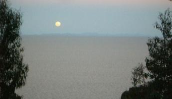 full moon rising over Lake Titicaca