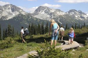 Family hiking on a tour of Alaska