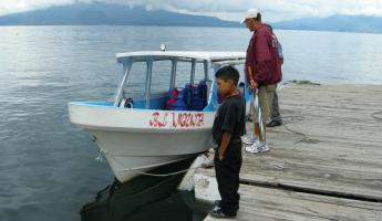 The boat, pilot, and Hugo on Lake Atitlan