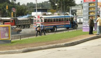 Chicken bus in Xela. Gas was priced by the gallon.