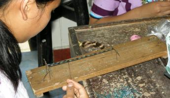 Weaving a bracelet in Santiago
