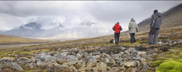 Walking through vast arctic landscapes.