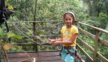 Hanging out on the platform after a rainforest zip line adventure!