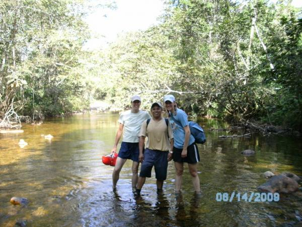 Wading through the river in route to the ATM cave