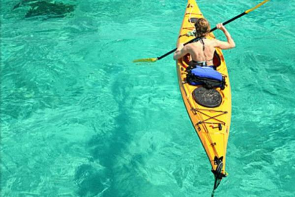 Kayaking off Glovers Reef Atoll