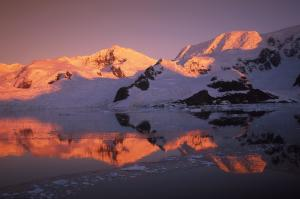 The sun sets over polar mountains