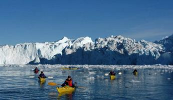 Kayak with massive icebergs