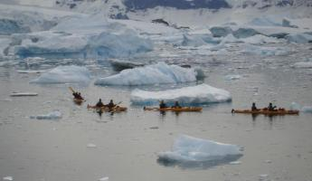 Kayakers work their way through ice at Curverville