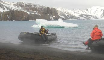 Steam rises off the water at Deception Island