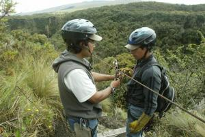 Getting clipped into the zipline for a bird's eye view of the Ecuadorian forest!
