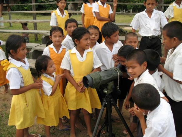 School children with a telescope