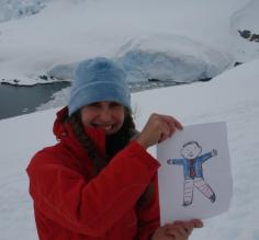 Beth and Flat Stanley at Paradise Bay in Antarctica