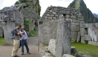 Looking at photos in Machu Picchu
