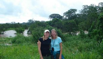 Mom and I with the flood behind us