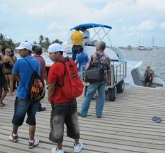 Arrived at Caye Caulker! - Waiting for our bags