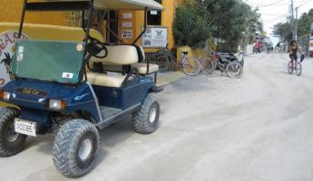 Golf cart - No vehicles are allowed on Caye Caulker.  Golf carts are like taxis here.