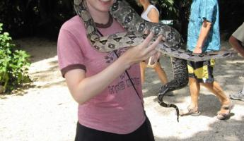 Holding a boa constricter at the Belize Zoo