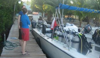 Getting ready to board the boat for the 3-tank dive to Turneffe