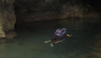 Swimming in to the entrance of the ATM cave